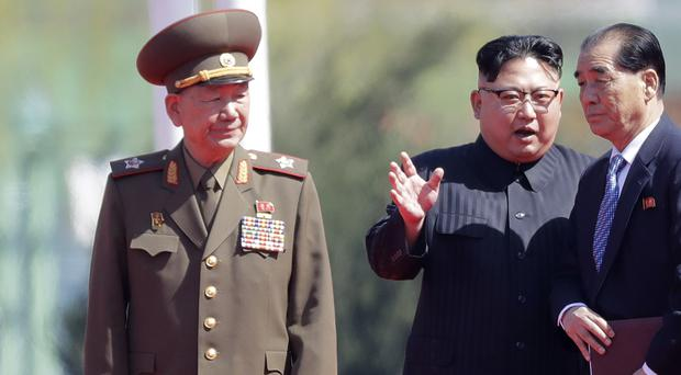 File photo showing Hwang Pyong So, left, standing near North Korean leader Kim Jong Un (centre) (AP)