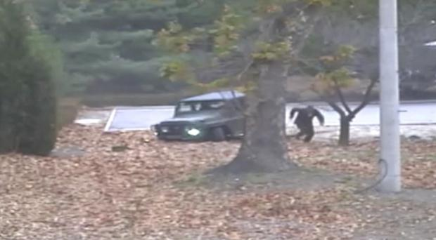 Footage shows a North Korean soldier dashing across the border (United Nations Command/AP)