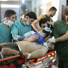 The JIM is investigating chemical weapons attacks in Syria (Aleppo Media Center via AP, File)