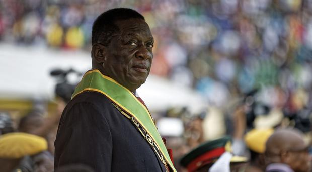 Emmerson Mnangagwa inspects the military parade after being sworn in as president (AP)