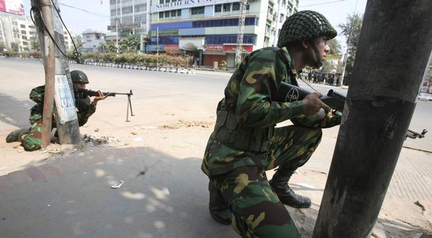 Bangladesh army soldiers take positions near the headquarters of Bangladesh Rifles in Dhaka in 2009 (AP Photo/Pavel Rahman, File)