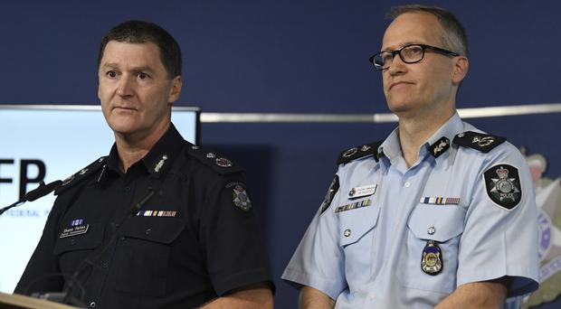 Australian Federal Police, Acting Deputy Commissioner Ian McCartney, right, and Victoria State Police Deputy Commissioner Shane Patton address the media after arresting a man accused of planning a mass shooting for New Year's Eve in Melbourne (James Ross/AAP Image via AP)