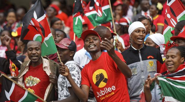Supporters attend the presidential inauguration at Kasarani Stadium in Nairobi (Ben Curtis/AP)