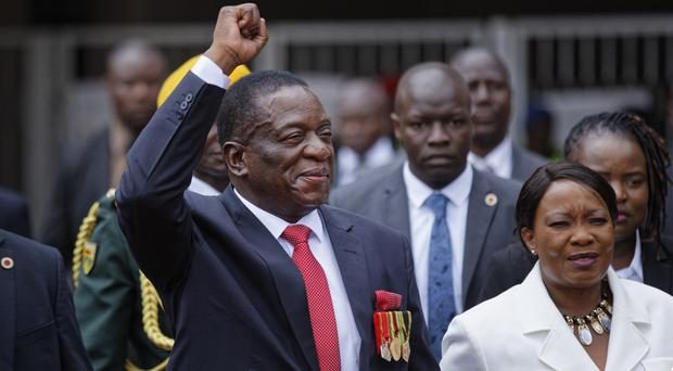 Emmerson Mnangagwa arriving at his presidential inauguration ceremony (AP)