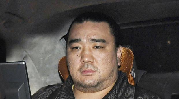 Harumafuji has decided to retire from sumo after allegations that he assaulted a lower-ranked wrestler and tarnished the image of Japan's national sport. (Daisuke Suzuki/Kyodo News via AP)