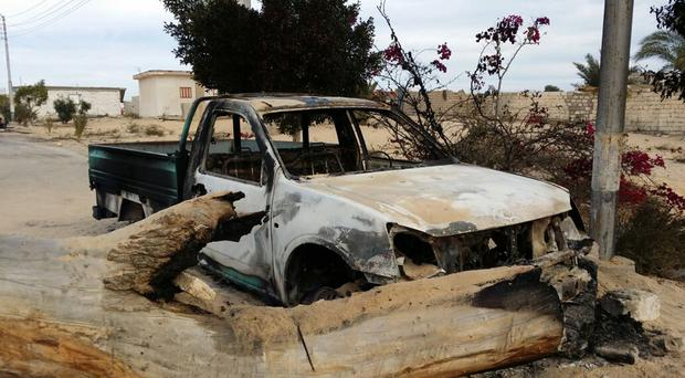 A burned truck is seen outside al-Rawdah mosque a day after attackers killed hundreds of worshippers (Tarek Samy/AP/PA)