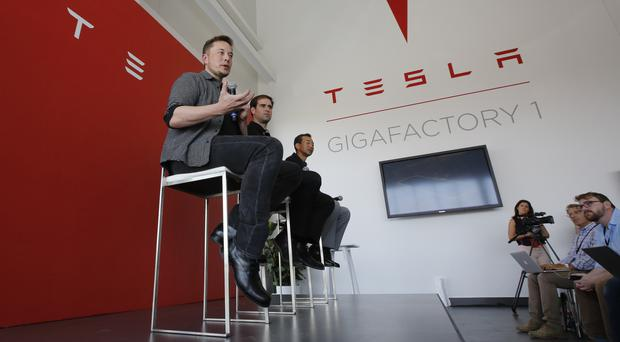 Elon Musk, CEO of Tesla Motors Inc., delivered on a promise by building the worlds biggest lithium-ion battery in the Australian Outback (AP Photo/Rich Pedroncelli, File)