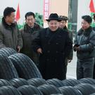 North Korean leader Kim Jong Un thanked workers at a factory that built the tires for a huge vehicle used to transport a new intercontinental ballistic missile that was test-launched last week. (Korean Central News Agency/Korea News Service via AP)