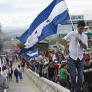 Supporters of opposition presidential candidate Salvador Nasralla march in protest (AP)