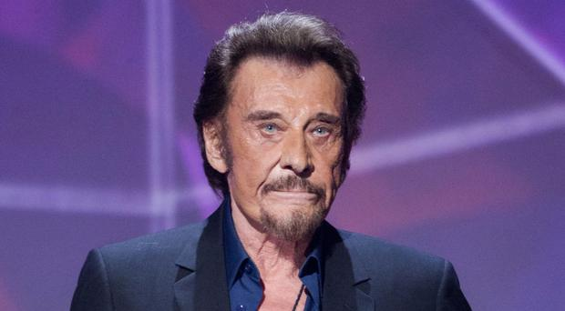 French singer Johnny Hallyday has died at age 74. (AP Photo/Jacques Brinon, File)
