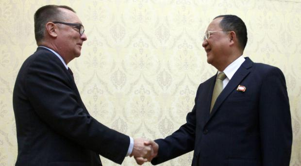 North Korean Foreign Minister Ri Yong Ho, right, and undersecretary-general for political affairs Jeffrey Feltman shake hands at the Mansudae Assembly Hall in Pyongyang, North Korea on Thursday (AP Photo/Jon Chol Jin)