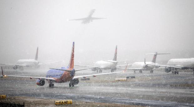 Delta cancels hundreds of flights amid winter storm