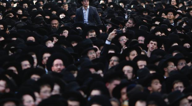 Thousand gather at the funeral Rabbi Aharon Leib Shteinman in the central Israeli city of Bnei Brak (AP)