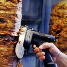 A man slices meat from a spit in a Frankfurt kebab restaurant (AP)