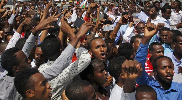 Somali protesters on the streets of Mogadishu (AP)