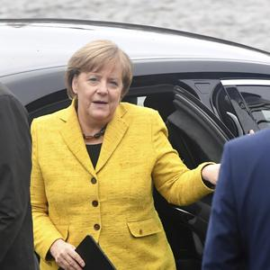 German Chancellor Angela Merkel arrives for a meeting of EPP leaders ahead of an EU summit in Brussels. (AP)