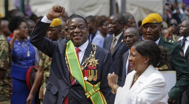 Emmerson Mnangagwa and his wife Auxillia (AP/Ben Curtis)