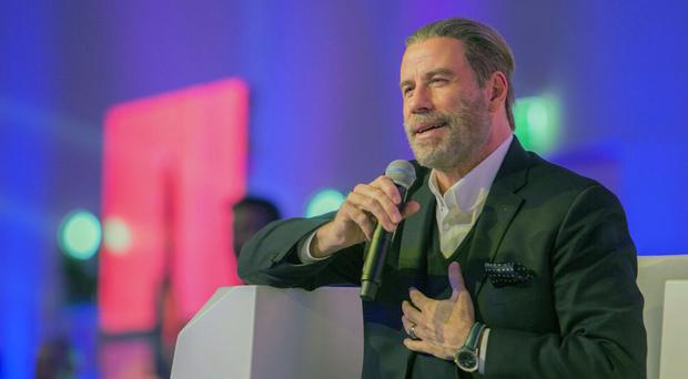 John Travolta talks at the Apex Convention Center in Riyadh, Saudi Arabia (Centre for International Communication, Ministry of Culture and Information/AP)