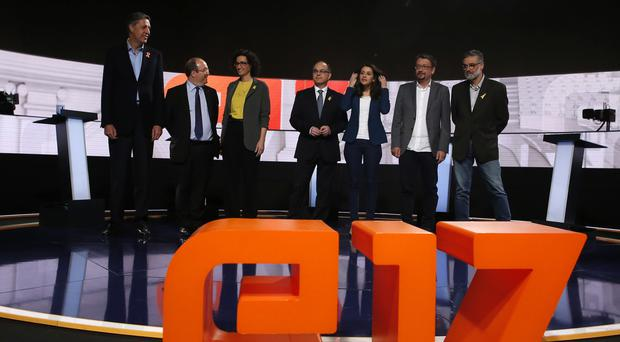 Catalan parties' candidates gather at the beginning of the last electoral television debate ahead of Thursday's regional election (AP)