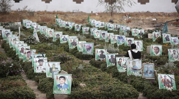 The graves of people killed during Yemen's ongoing conflict at a cemetery in Sanaa (AP)