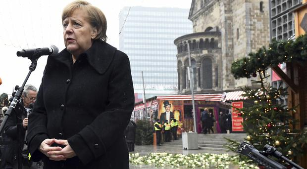 Angela Merkel speaks at the opening of a memorial site in Berlin (dpa/AP)