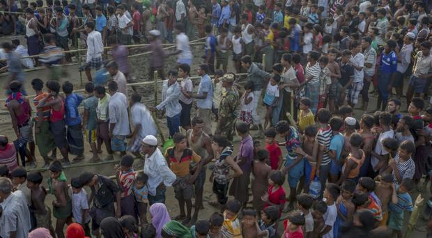 Rohingya Muslims fleeing into Bangladesh (AP)