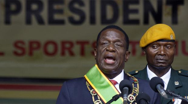 Emmerson Mnangagwa has vowed to open up the country to foreign investment (AP)