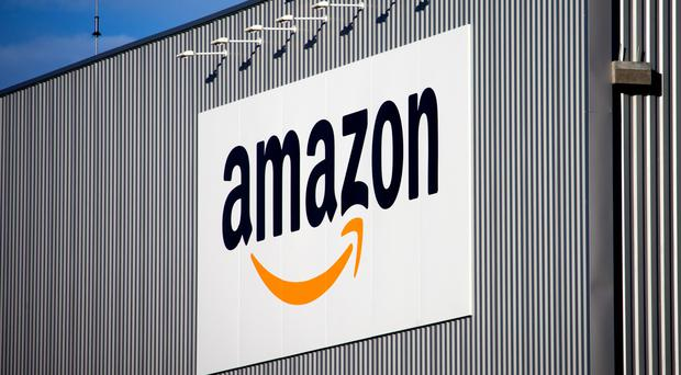 Amazon and Argos are both offering home delivery for those who have left their shopping to the very final hours. (AP)