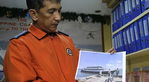 Coast guard spokesman Armand Balilo talks to reporters in Manila (AP Photo/Aaron Favila)
