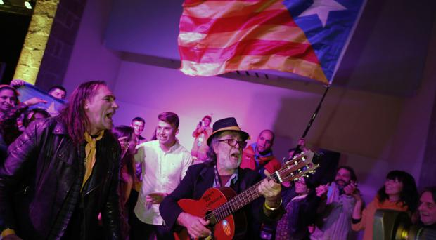 Catalan independence supporters celebrate at the ANC (Catalan National Assembly) headquarters after results of the regional elections in Barcelona (AP Photo/Emilio Morenatti)