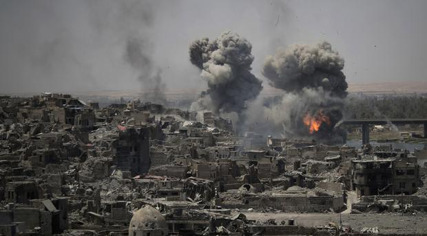 Airstrikes target Islamic State positions on the edge of the Old City in Mosul, Iraq (AP Photo/Felipe Dana, File)