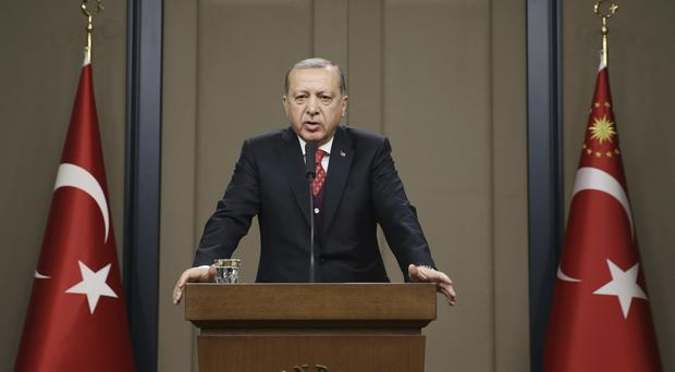Turkey's President Recep Tayyip Erdogan has been carrying out a purge of public sector workers (AP)