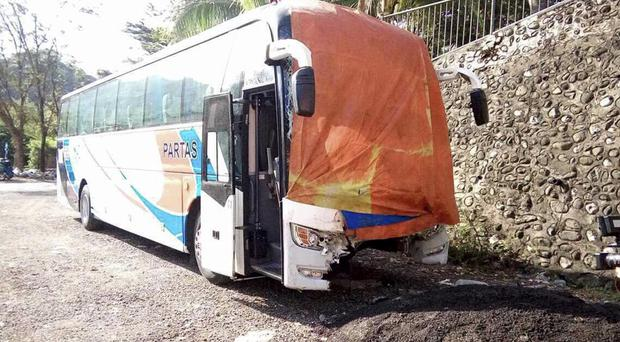 The coach collided with a van carrying pilgrims to Christmas Mass at a church in the northern Philippines (AP)