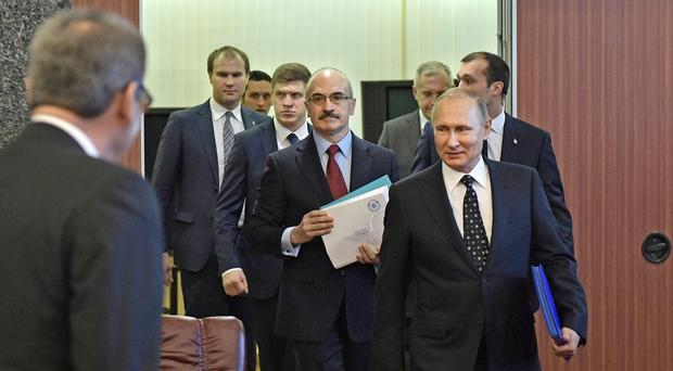 Vladimir Putin arrives to submit endorsement papers (Alexei Nikolsky, Sputnik, Kremlin Pool Photo via AP)