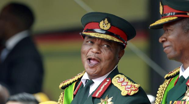 Constantino Chiwenga smiles during the presidential inauguration ceremony in Harare, Zimbabwe (Tsvangirayi Mukwazhi/AP)