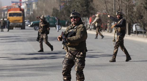 Soldiers patrol outside the site of a suicide attack in Kabul, Afghanistan (AP)