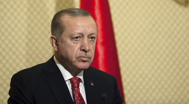 Recep Tayyip Erdogan described the leaders of Germany, the Netherlands and Belgium as 'old friends' (Hassene Dridi/AP)