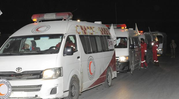 Members of the Syrian Arab Red Crescent helped with the latest evacuation (SANA via AP)