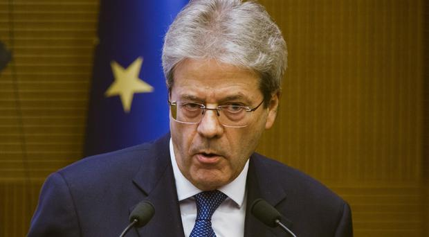 Paolo Gentiloni speaks during his a year-end press conference in Rome (AP Photo/Domenico Stinellis)