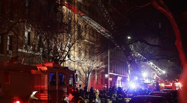 Firefighters respond to a building fire in the Bronx borough of New York (AP/Frank Franklin II)