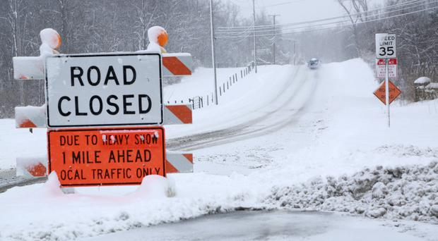 A road closed to traffic in Ohio as severe cold and bone-chilling winds are gripping most of the state (Lynn Ischay/The Plain Dealer via AP)