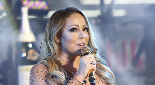 Mariah Carey performed again after a bungled performance last year (Greg Allen/Invision/AP)
