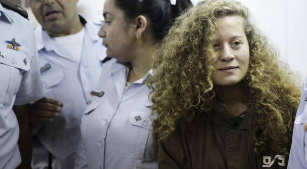 Ahed Tamimi is taken to a courtroom inside Ofer military prison near Jerusalem (Mahmoud Illean/AP/PA)