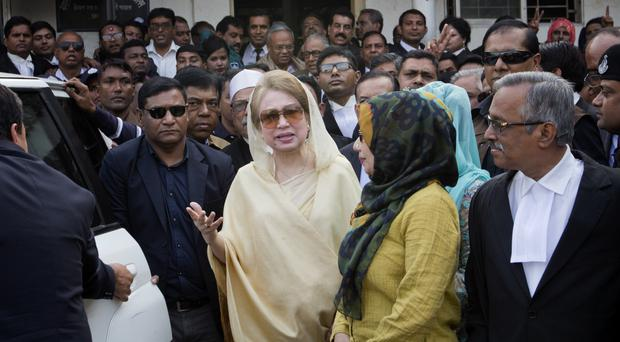 Khaleda Zia, centre, leaves after a court appearance in Dhaka last week (AP)