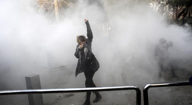The anti-government protests are the largest in Iran since its disputed 2009 presidential election (AP)