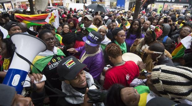 Zimbabweans outside the Zimbabwe Embassy in London during the political turmoil that culminated in the ousting of Robert Mugabe