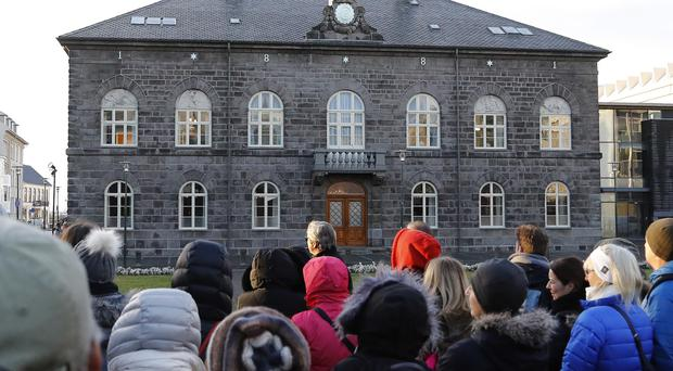 File photo of people looking at the Icelandic parliament, the Althing, in Reykjavik (AP)