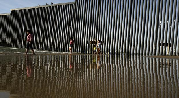 The Trump administration has proposed spending 18 billion dollars over 10 years to significantly extend the border wall with Mexico. (AP Photo/Gregory Bull, File)