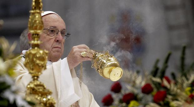 Pope Francis incenses the altar as he celebrates an Epiphany Mass in St Peter's Basilica at the Vatican (AP)