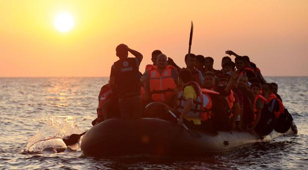 File photo of migrants and refugees on a boat